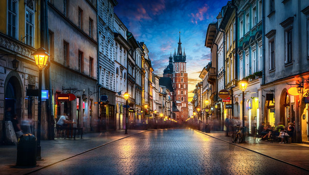 Evening view of St. Mary's Basilica from the Florianska street, old town Krakow, Poland. Panoramic view, long exposure, timelapse.