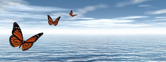 Butterflies flying to the horizon upon the ocean - 3D render