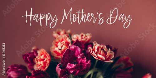Happy Mothers day quote. Beautiful Bunch of Peony Style Tulips in the Vase on the dusty pink background, spring holiday concept, banner size