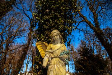 Fototapete - Beautiful sad angel. Vintage styled image of ancient statue.