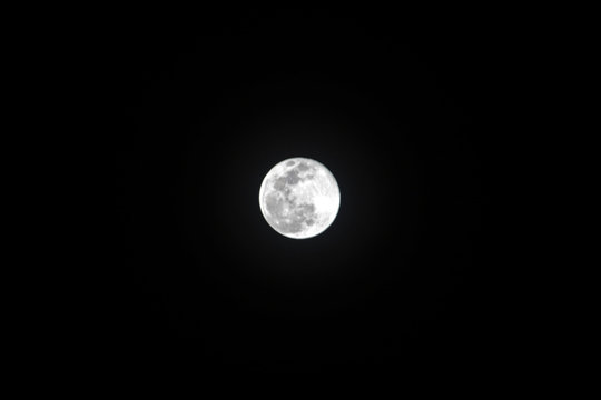 Full moon against clear black sky, Super Moon on March 9th 2020 - Worm Moon
