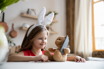 Happy girl playing with teddy bear stock photo Fotobehang