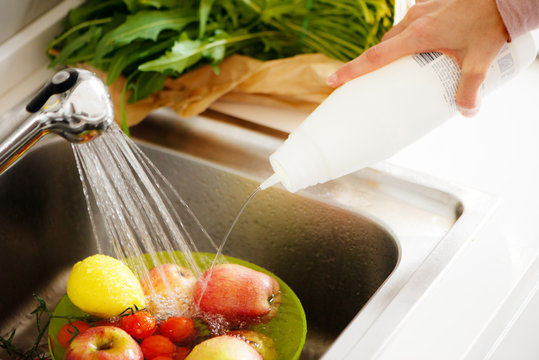 Washing fruit adding sterilizing liquid