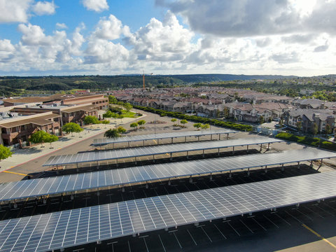 Aerial view of solar power plant installed on top of a parking lot. Renewable Energy: Solar Panels on the top of parking lot roof