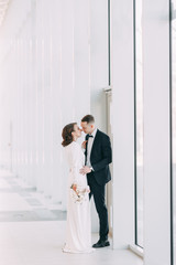 The bride and groom's romantic photo shoot. The newlyweds are happy together. Stylish modern couple...