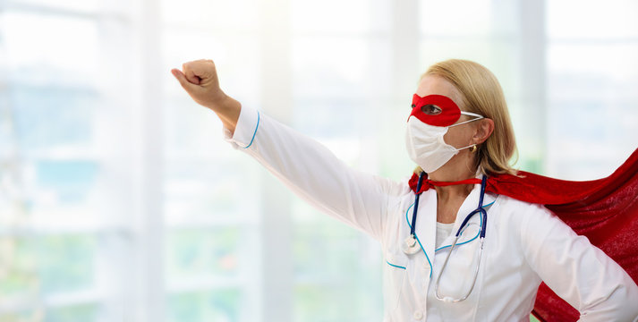 Doctor or nurse in face mask and superhero cape.