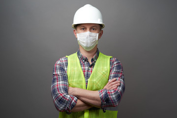 Worker man wearing hygienic mask and protective hard hat