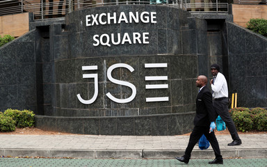 Security officers walk past the Johannesburg Stock Exchange (JSE) in Sandton