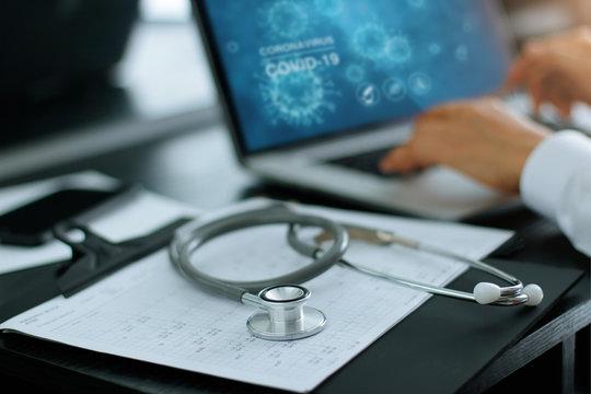 Stethoscope medical and doctor analysis coronavirus or covid-19 data on laptop computer on laboratory background.