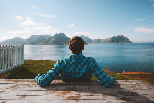 Man relaxing on beach enjoying sea view adventure travel summer vacations outdoor in Norway healthy lifestyle success wellness concept