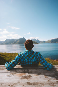 Man enjoying sea view resort travel summer tourism vacation outdoor in Norway healthy lifestyle success wellness concept