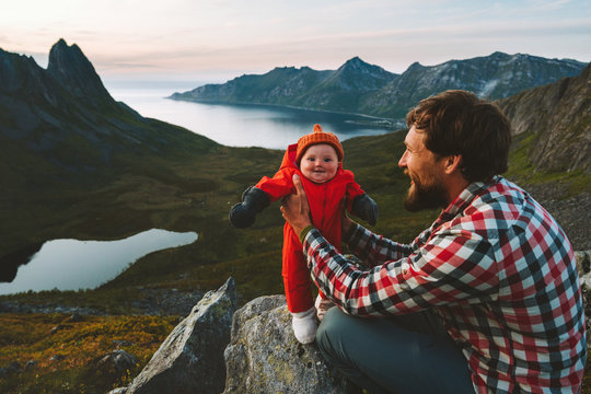 Father hiking with infant baby travel family healthy lifestyle adventure vacations trip in mountains happy smiling baby daughter with dad together outdoor