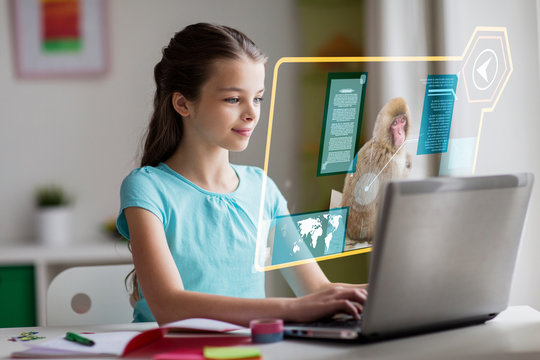 education, school and technology concept - girl with laptop computer and hologram projection learning nature online at home