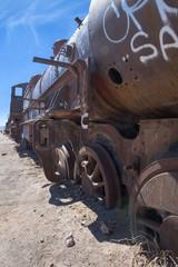 Rusty decayed train wrecks on the train cemetery near Uyuni, Bolivia
