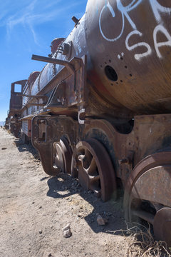 Rusty decayed train wrecks on the train cemetery near Uyuni, Bolivia