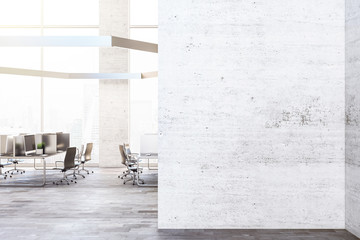 Contemporary coworking office interior with blank wall