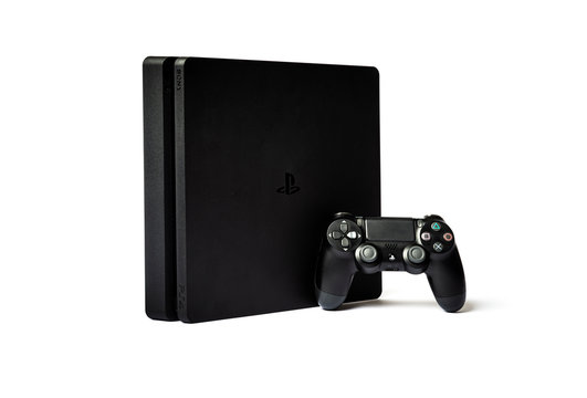 Sony PlayStation 4  and game controller on white background