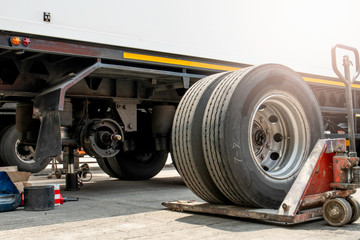 truck spare wheels ,tire waiting for to change, trailer wheels maintenance