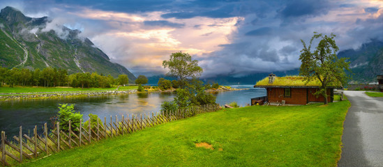 Eidfjord river with fishing hut at sunset. Eidfjord, Norway, Scandinavia