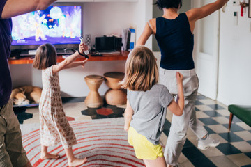 Canvas Prints Dance School Family dancing together indoor playing videogame