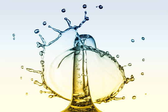 Multi coloured water droplet and splash crown