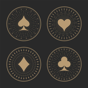 Playing cards suits icons with art deco frames. Old golden ornament patterns and casino symbols on dark background. The style of the 1920s - 1930s. Vector illustration.