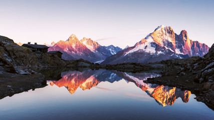 Fotobehang Alpen Colourful sunset on Lac Blanc lake in France Alps. Monte Bianco mountain range on background. Vallon de Berard Nature Preserve, Chamonix, Graian Alps. Landscape photography