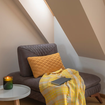 Cozy nook by the window with yellow blanket and pillow on a coach
