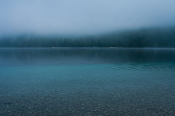 misty morning fog on the lake in Bohinj, Slovenia