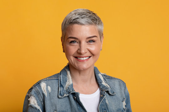 Portrait Of Beautiful Mature Woman With Short Hair Smiling At Camera