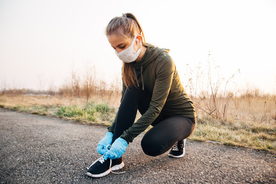 COVID-19 Pandemic Coronavirus girl in mask and blue gloves during quarantine went out to run