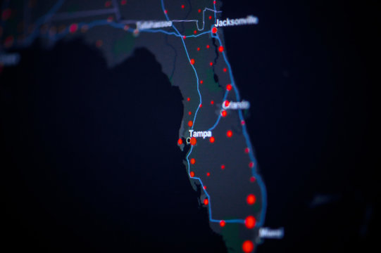 United States, florida, Tampa . Coronavirus COVID-19 global cases Map. Red Point showing the number of infected. World map on monitor display.