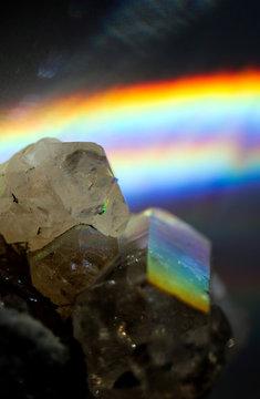 Amazing natural light reflections on healing Smokey Quartz wild jewels. Texture of gemstone with rainbow effect.