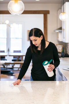 Woman Using Cloth To Disinfect And Clean Counter