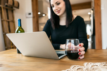 Staying Home: Woman Using Laptop To Have Wine With Friends Wall mural