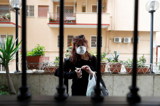Italian chef Laura Carrera, 37, is seen on her way home after she went to the market wearing safe mask and gloves as the spread of coronavirus disease (COVID-19) continues, in Rome