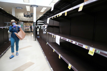 An empty toilet paper aisle is seen at Ralphs Kroger grocery store after California issued a stay-at-home order in an effort to prevent the spread of coronavirus disease (COVID-19), in Los Angeles