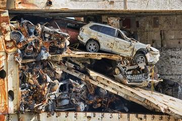 Acrylic Prints Shipwreck Wrecked car reamains in a big pile on a broken, sunk ship