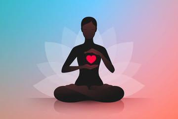 Fototapeta Woman sitting in lotus position and holding hands near her red heart obraz