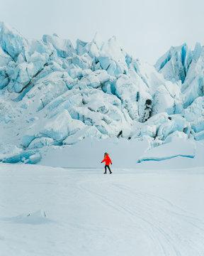 Woman walking on snowy landscape