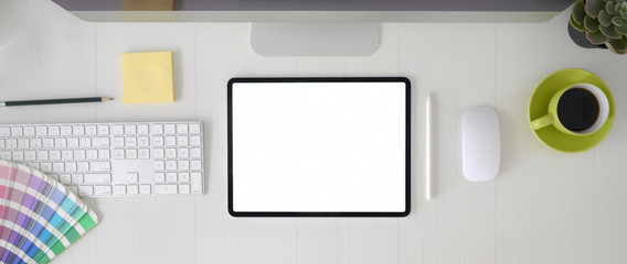 Wall Mural - Top view of graphic designer workspace with blank screen tablet, computer device and designer supplies