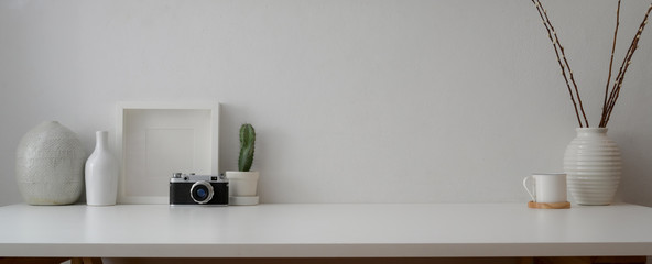 Cropped shot of minimal workspace with camera, decorations and copy space