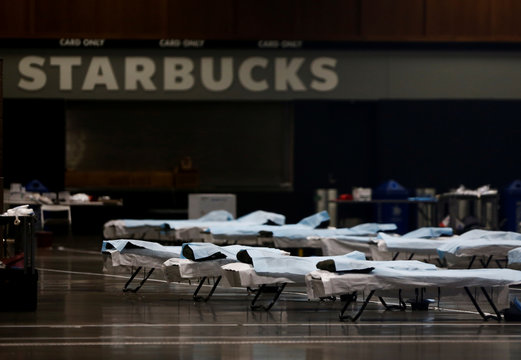 Beds are set up in front of a large Starbucks sign at the CenturyLink Field Event Center, which is being turned into a military field hospital for non coronavirus patients during the coronavirus disease (COVID-19) outbreak in Seattle