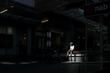 A bicycle delivery man wears a face mask during the implementation of stricter social-distancing and self-isolation rules to limit the spread of the coronavirus disease (COVID-19) in Sydney