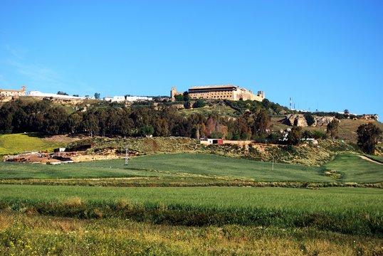 View across farmland towards the Parador (Alcazar del Rey Don Pedro) on the hill, Carmona, Spain.