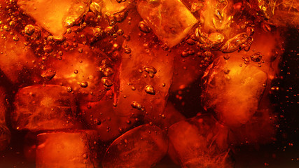 Fototapeta Detail of cola drink with ice cubes