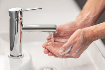 Washing hands rubbing with soap man for corona virus prevention, hygiene to stop spreading...