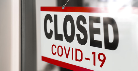 Wall Murals London Closed businesses for COVID-19 pandemic outbreak, closure sign on retail store window banner background. Government shutdown of restaurants, shopping stores, non essential services.