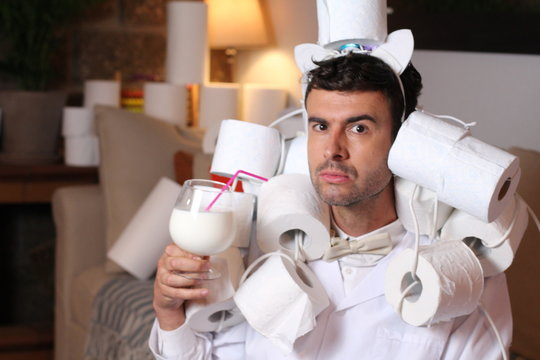Fashionable man stocking up toilet paper at home