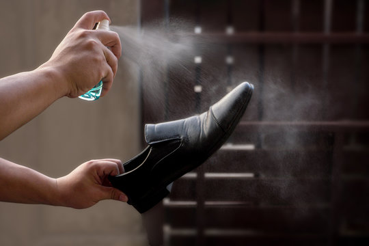 Preventive measures against Covid-19 infection. A man cleans his shoes